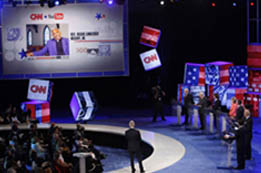 Democratic candidates field questions at the CNN/YouTube debate in South Carolina in July 2007. (© AP Images/Charles Dharapak)