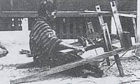 Photo of a woman working on an old loom