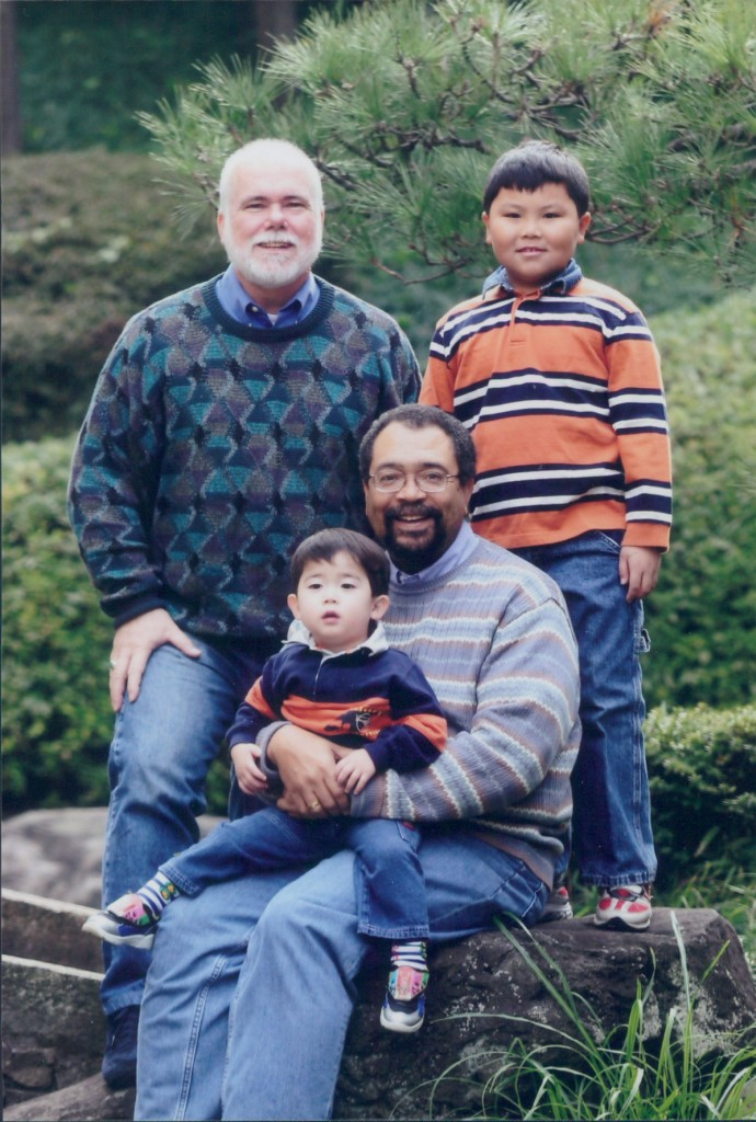 Photo of Harold J Ashby, Jr., his husband and partner Ed McKeon, and his two sons