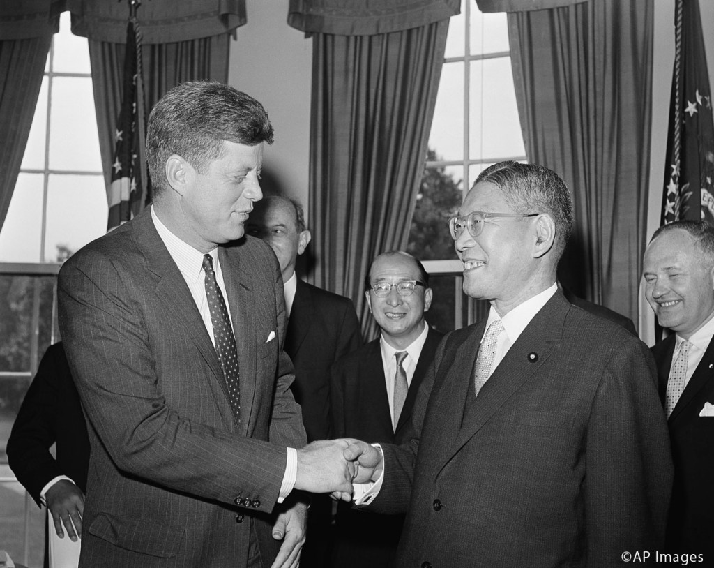 President John Kennedy shakes hands with Japanese Prime Minister Hayato Ikeda, at right, at the White House in Washington, June 21, 1961. (AP Photo)