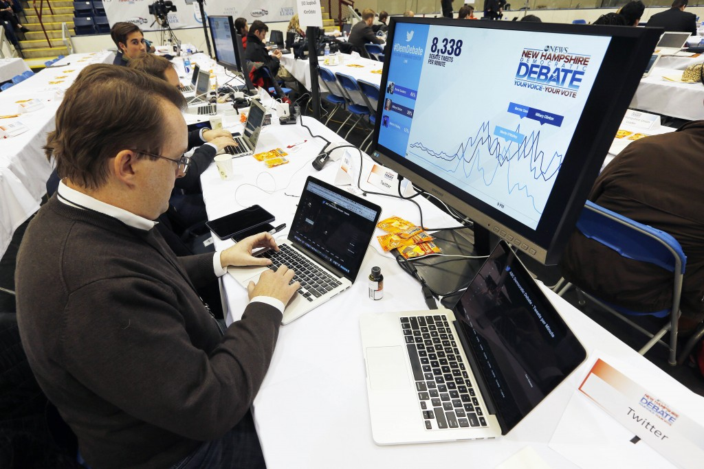 Twitter employee Adam Sharp monitors data from the service during the Democratic presidential primary debate, Saturday, Dec. 19, 2015, at Saint Anselm College in Manchester, N.H. (AP Photo/Michael Dwyer)