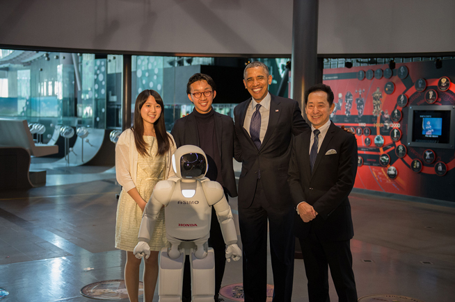 President Obama Poses for a Photo with ASIMO and Students