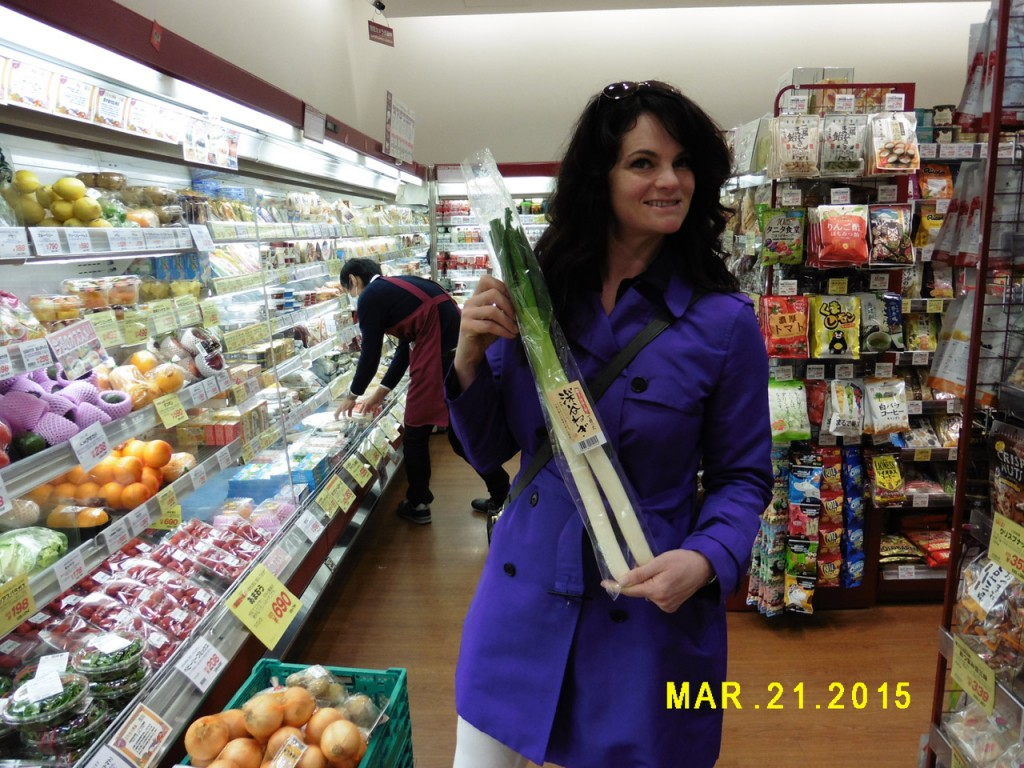Rosella Mosby, co-owner of Mosby Farms, examines the produce in a Japanese supermarket