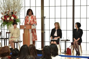 a picture of the first lady giving a speech in Tokyo