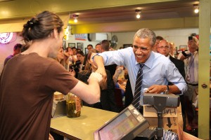 President Barack Obama made an unscheduled stop at Franklins BBQ after his speech downtown and proceeded to cut in line but did buy some patrons their food while shaking hands with people on his way out of town. He shares a hearty laugh with worker Daniel Webb as he processes his order of over $400 in barbeque. (AP Photo/Austin American-Statesman, Ralph Barrera)Austin Chronicle Out, Community Impact Out, Internet Must Credit Photographer and Statesman.com