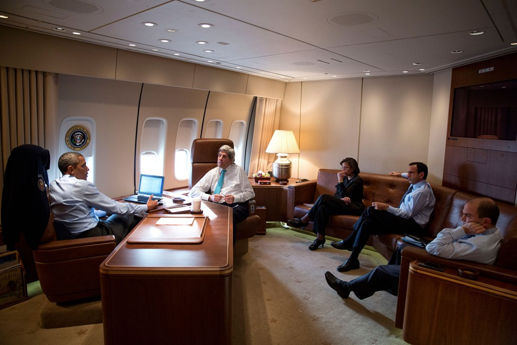 President Obama meets with Secretary of State John Kerry, National Security Adviser Susan E. Rice and other advisers in his office aboard Air Force One. (White House)