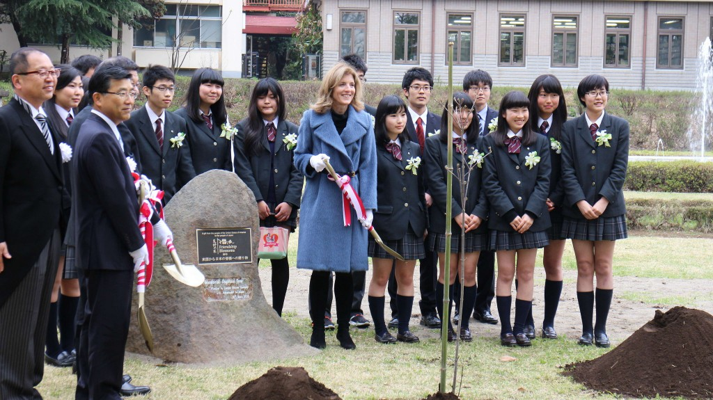Ambassador Kennedy plants a dogwood tree at Tokyo Metropolitan Engei High School during an event