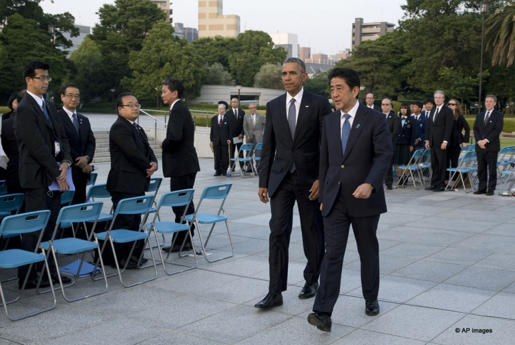U.S. President Barack Obama, left, and Japanese Prime Minister Shinzo Abe walk from the ceremony at Hiroshima Peace Memorial Park to have a closer look of the Atomic Bomb Dome in Hiroshima, western Japan, Friday, May 27, 2016. Obama on Friday became the first sitting U.S. president to visit the site of the world's first atomic bomb attack, bringing global attention both to survivors and to his unfulfilled vision of a world without nuclear weapons. (AP Photo/Carolyn Kaster)