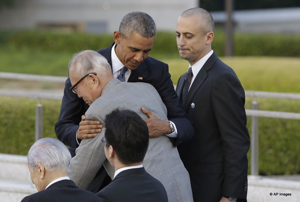 U.S. President Barack Obama hugs Shigeaki Mori, an atomic bomb survivor and a creator of the memorial for American WWII POWs killed in Hiroshima, during a ceremony at Hiroshima Peace Memorial Park in Hiroshima, western, Japan, Friday, May 27, 2016. Obama on Friday became the first sitting U.S. president to visit the site of the world's first atomic bomb attack, bringing global attention both to survivors and to his unfulfilled vision of a world without nuclear weapons. (AP Photo/Carolyn Kaster)