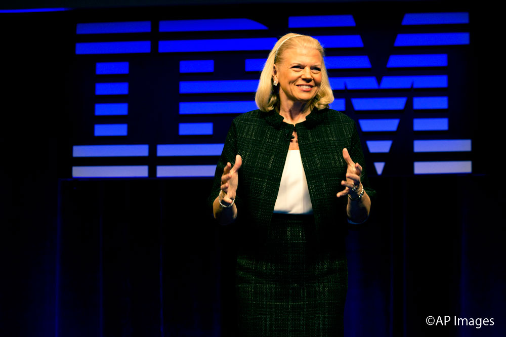 IBM CEO Ginni Rometty responds to a question during a news conference at IBM Watson headquarters, in New York, Thursday, April 30, 2015. Apple, IBM and Japanese insurance and bank holding company Japan Post have formed a partnership to improve the lives of elderly people in the country. The program will provide iPads with apps designed to help seniors manage day-to-day lives and keep in touch with family members. (AP Photo/Richard Drew)