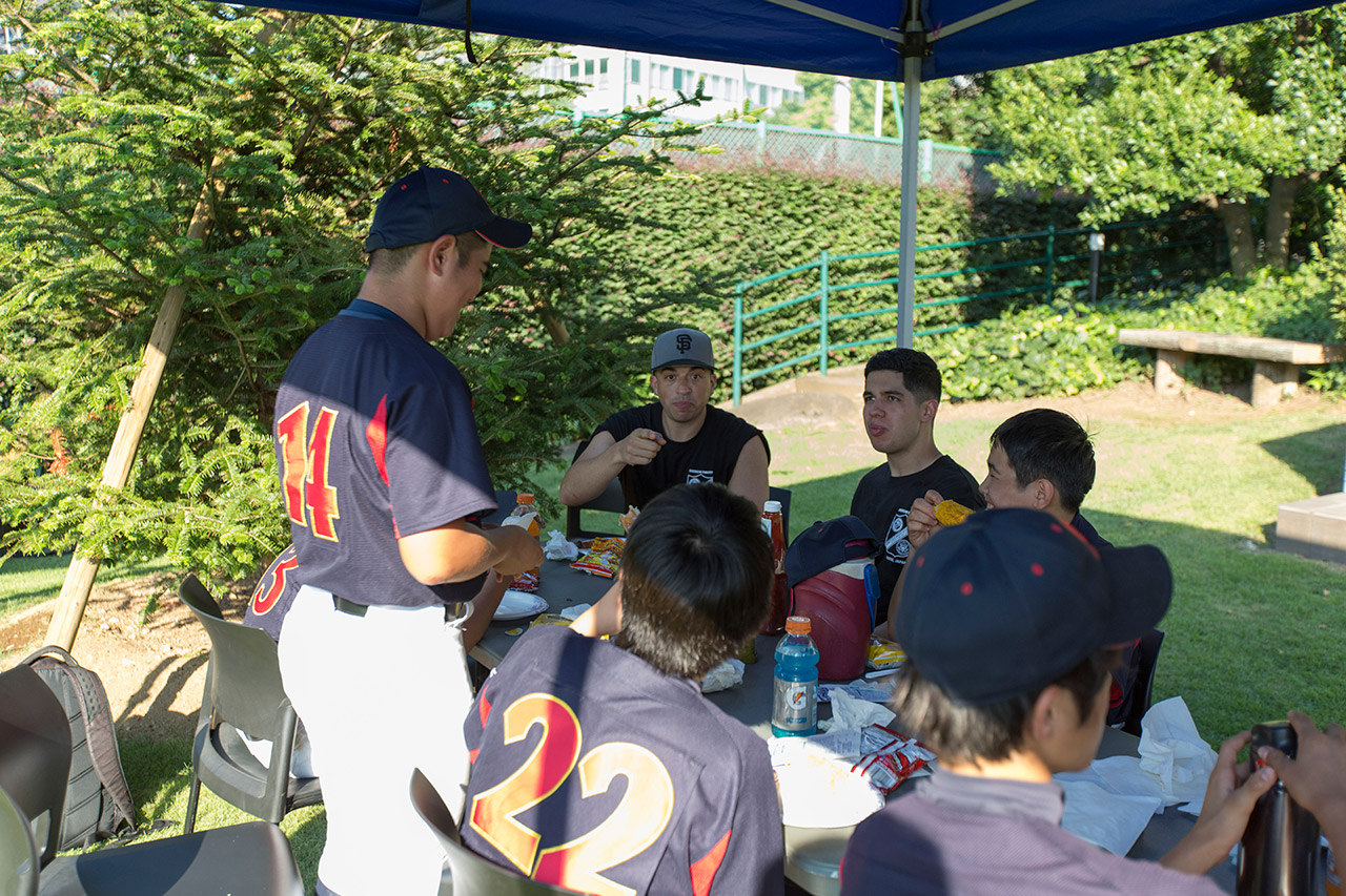 The young players chatted with the Marines about baseball.