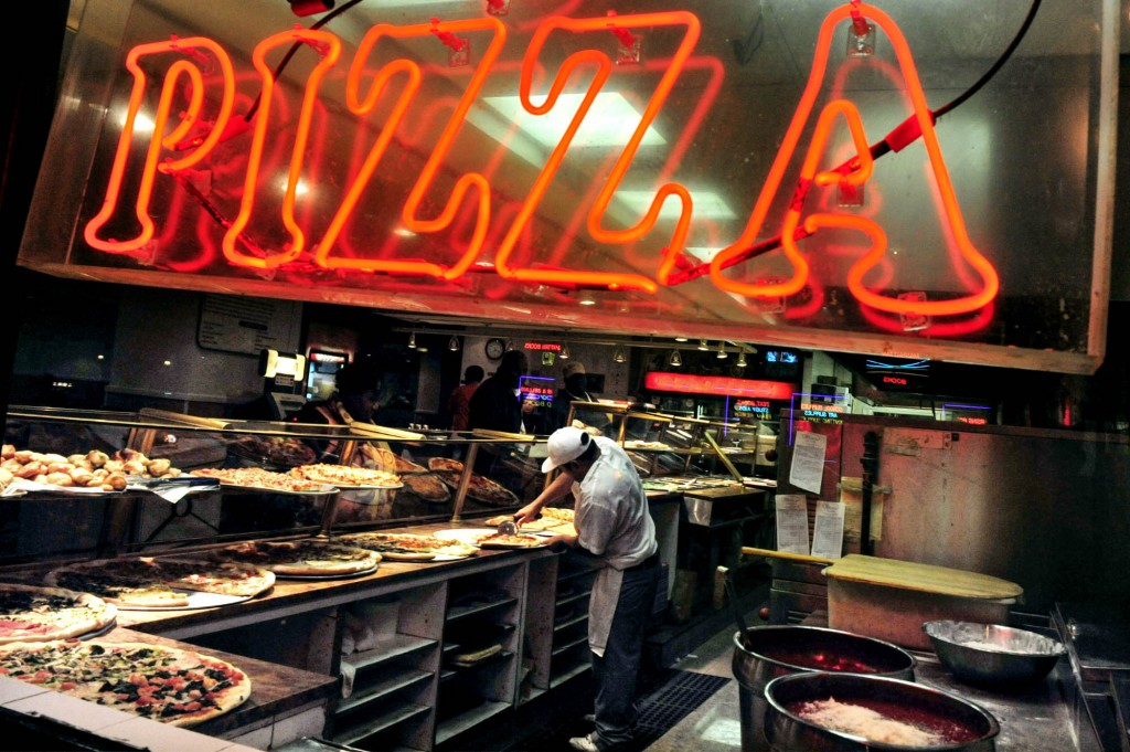 Americans' love of pizza reflects a shift in attitudes and culture. (© AP Images)