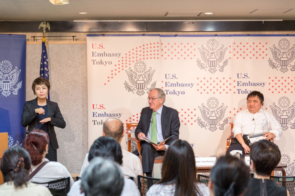 "Former Senator Tom Harkin speaks on ""26 years of the ADA: Successes and Next Steps"" at the American Center Japan in Tokyo on September 26, 2016. Keiichi Tamaru, Assistant Secretary General, Japan National Assembly of Disabled People, moderated the event."