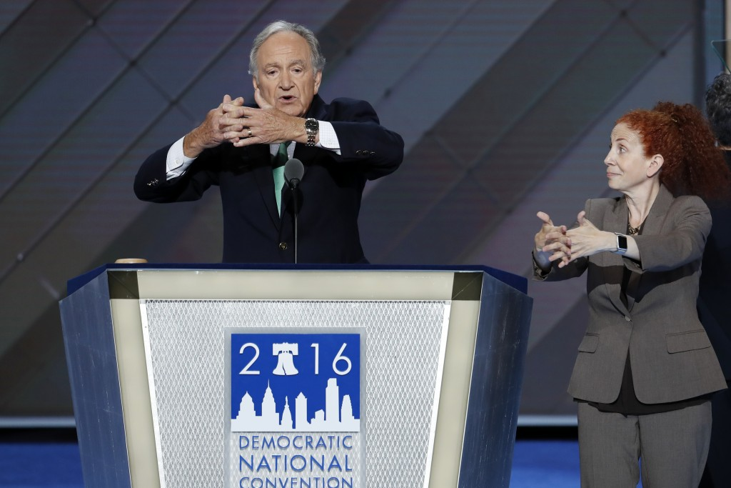 Former Senator Tom Harkin uses sign language as he speaks during the Democratic National Convention in Philadelphia on July 26, 2016. (AP Photo/J. Scott Applewhite)