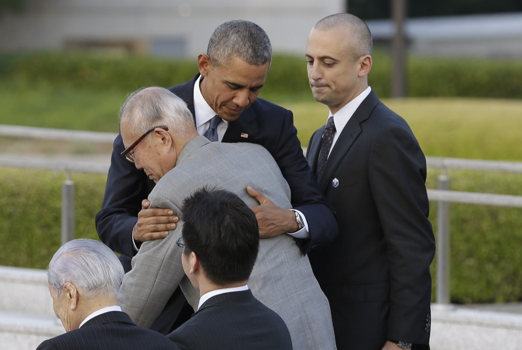 U.S. President Barack Obama hugs Shigeaki Mori at Hiroshima Peace Memorial Park in Hiroshima on May 27, 2016. (AP Photo/Carolyn Kaster)