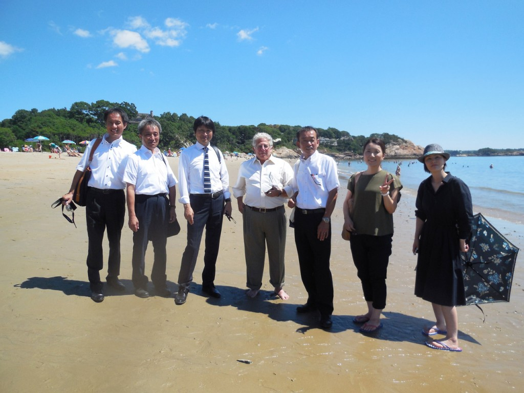 The delegation from Kyotango visits Singing Beach in Manchester-by-the-Sea with Peter Grilli, Senior Advisor of the Japan Society of Boston (center)