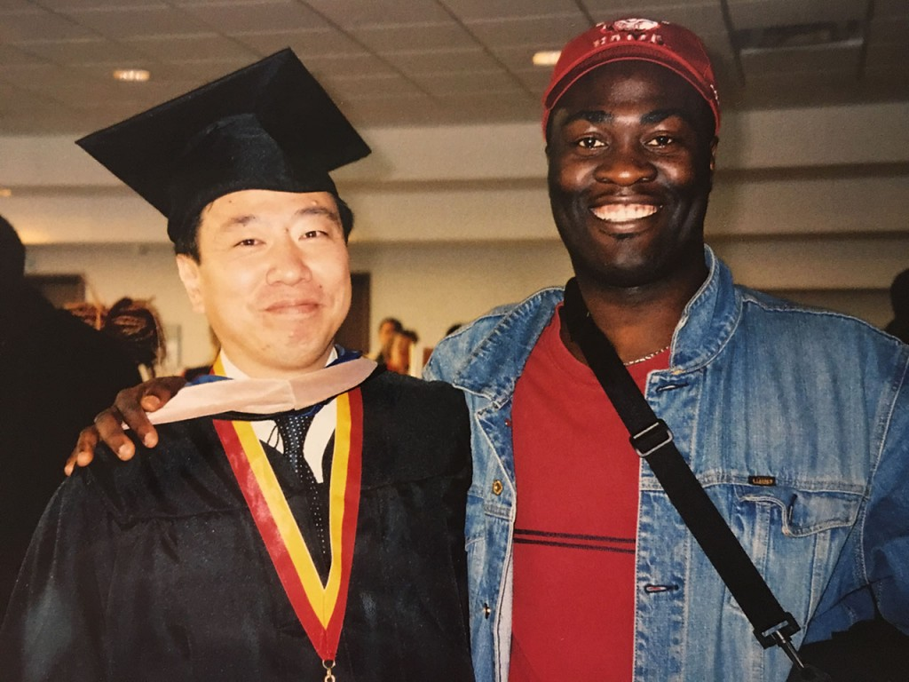 Suga with a friend at his graduation from the MBA program at Georgia State University.