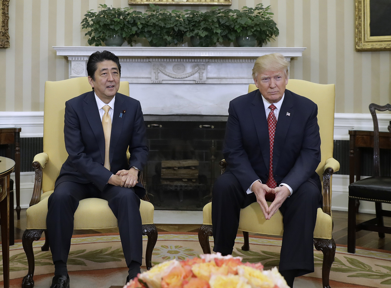 President Donald Trump meets with Japanese Prime Minister Shinzo Abe in the Oval Office of the White House in Washington, Friday, Feb. 10, 2017. (AP Photo/Evan Vucci)