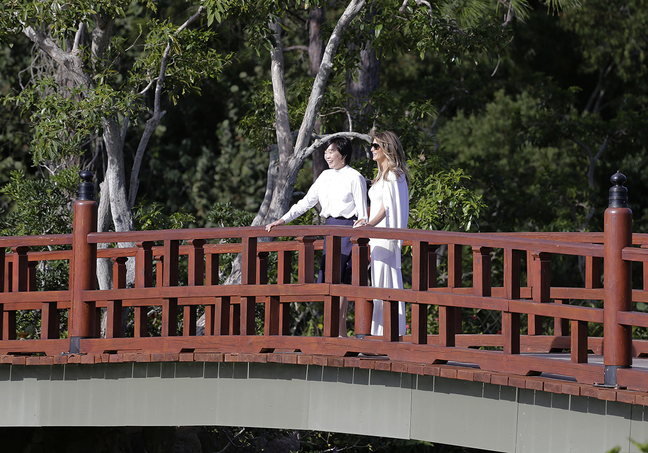 Akie Abe, wife of Japanese Prime Minister Shinzo Abe, left, and first lady Melania Trump tour Morikami Meseum and Japanese Gardens in Delray Beach, Fla., on Saturday, Feb. 11, 2017. (AP Photo/Terry Renna)