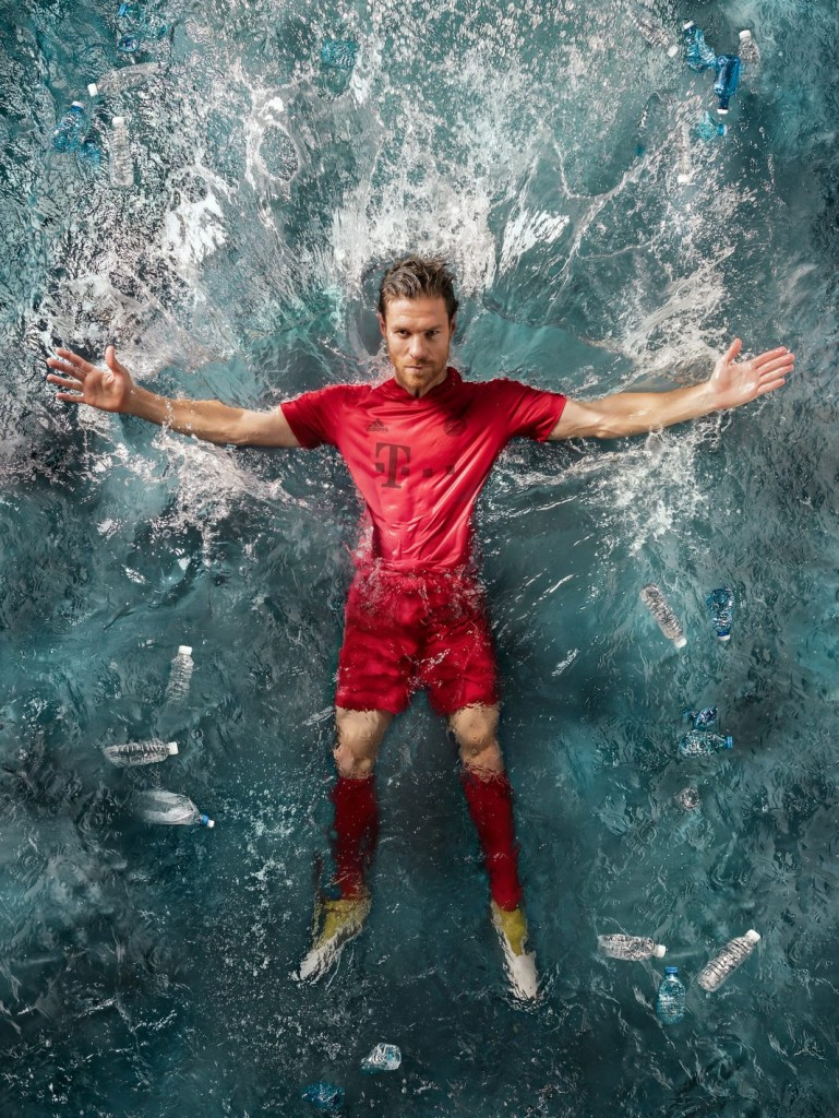 Bayern Munich star Xabi Alonso shows off a new jersey made entirely of recycled ocean debris. (Courtesy photo)