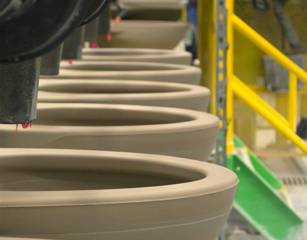 Toilets on the TOTO USA production line. TOTO's decision to build toilets in the U.S. enables the Japanese company to work with U.S. engineers and save costs. (TOTO USA)