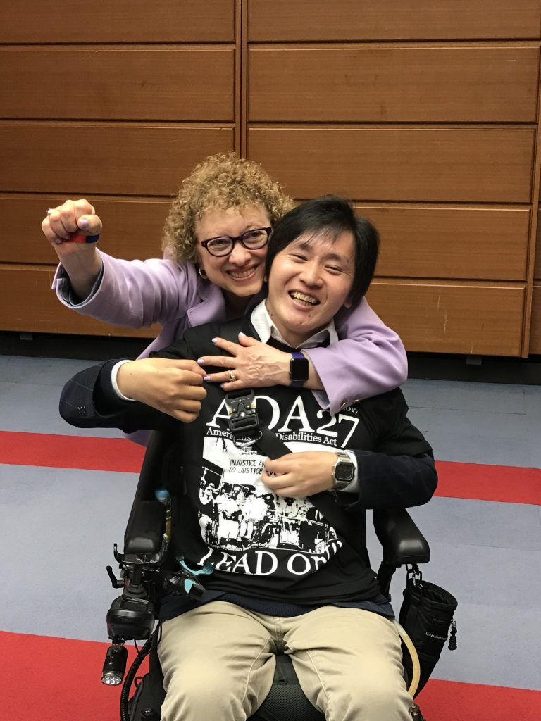 Joyce Bender interacts with a participant in a program in Nagoya.