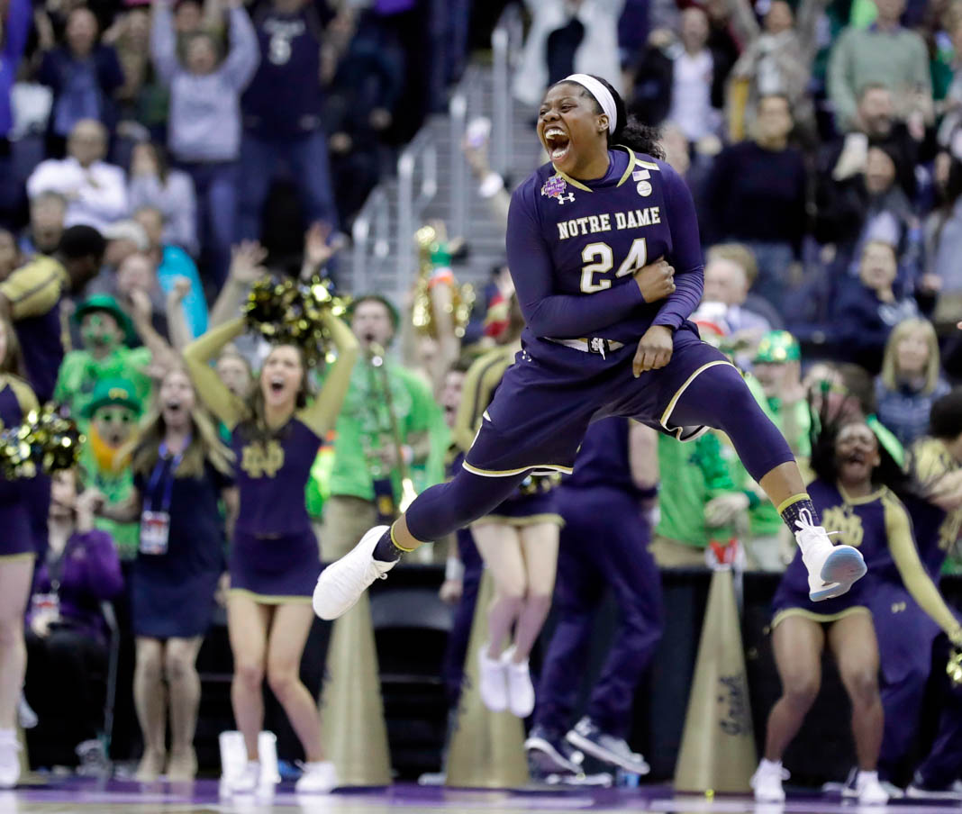 Notre Dame's Arike Ogunbowale celebrates after making the game-winning basket during overtime against Connecticut in the semifinals of the 2018 women's NCAA Final Four college basketball tournament. (© Ron Schwane/AP Images)