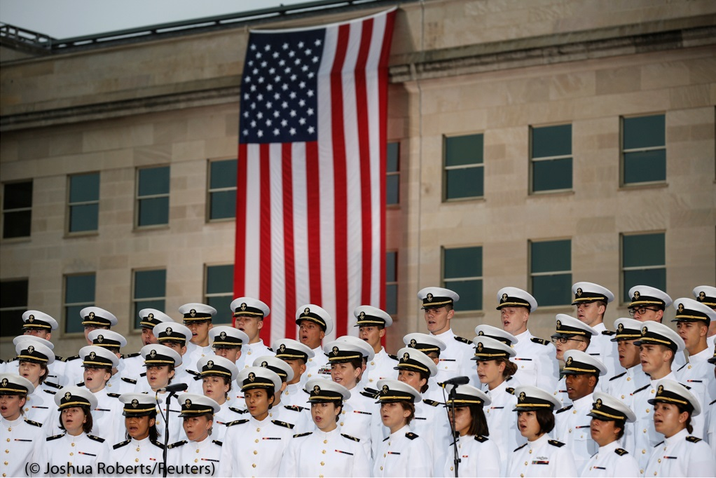 The U.S. Naval Academy Glee Club performs at the 17th annual September 11 observance ceremony at the Pentagon Memorial in Virginia. American Airlines Flight 77 struck the military headquarters on 9/11, killing 184 people.