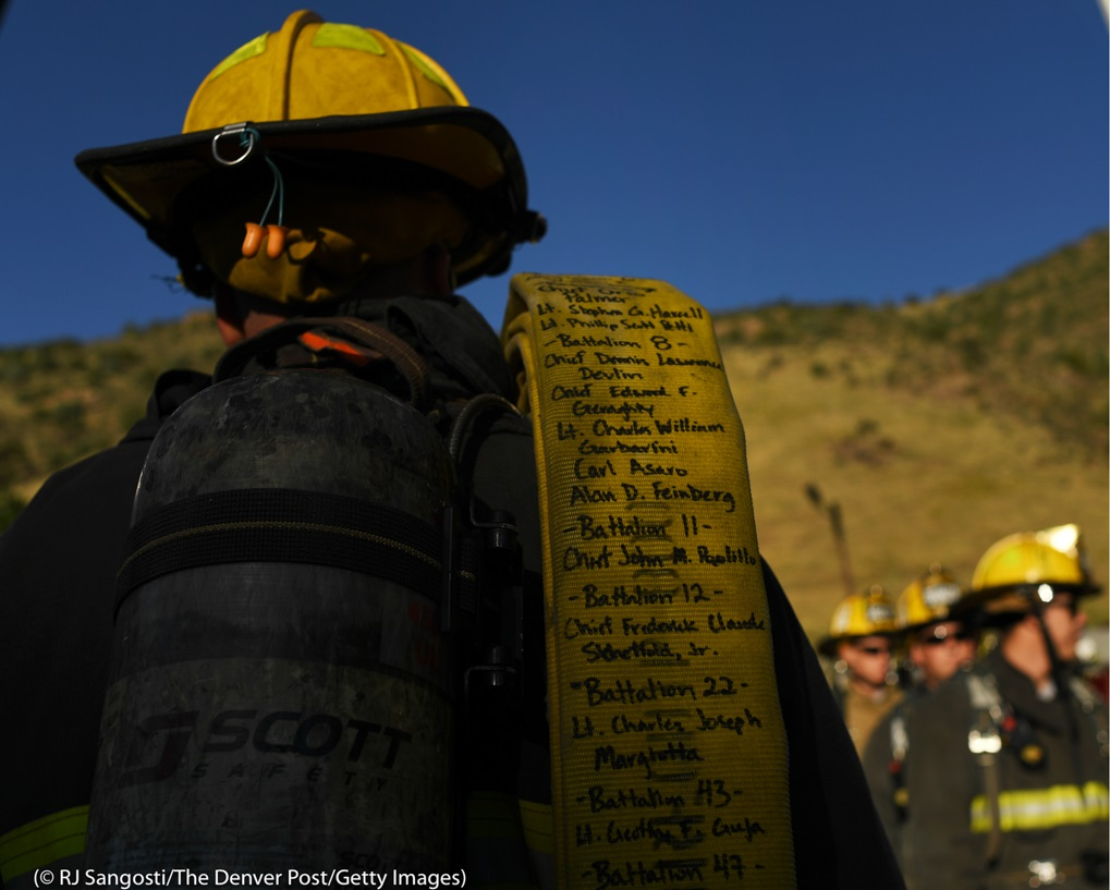 At Red Rocks Amphitheatre in Morrison, Colorado, a firefighter carries a fire hose with the names of the 343 firefighters who died on 9/11 trying to rescue victims trapped in New York's Twin Towers. The event, called the Colorado 9/11 Memorial Stair Climb, takes place each year to remember those who died that day.