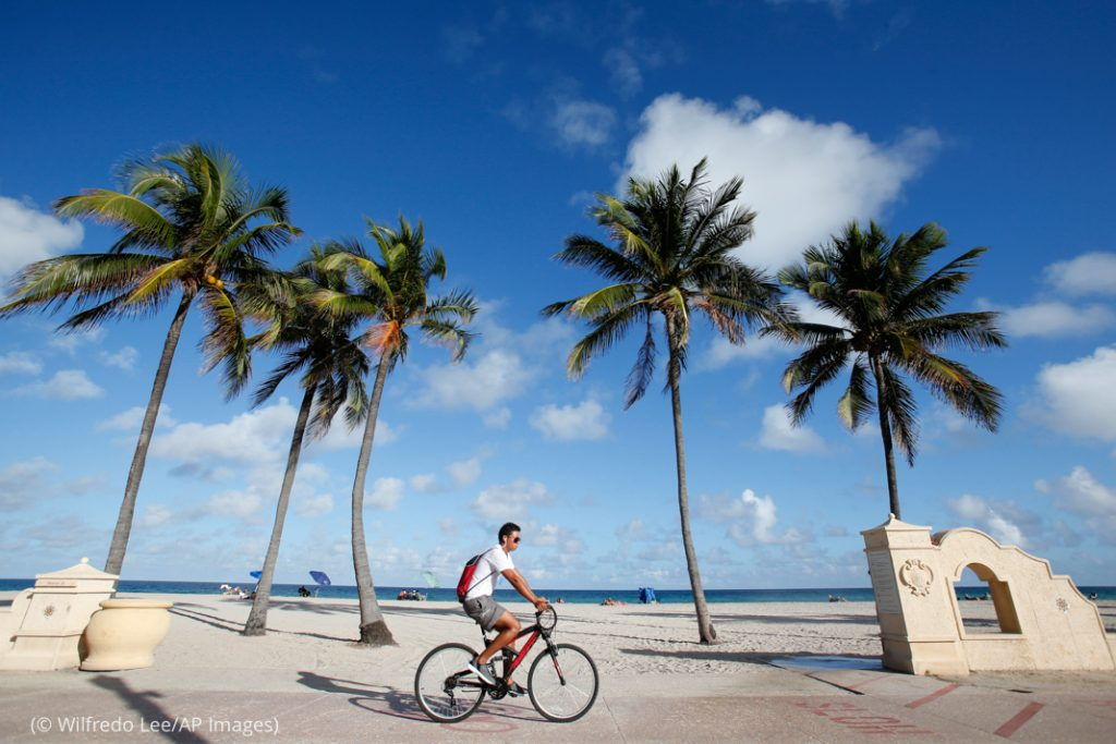 A cyclist rides along the Hollywood Beach Broadwalk in Hollywood, Florida. (© Wilfredo Lee/AP Images)