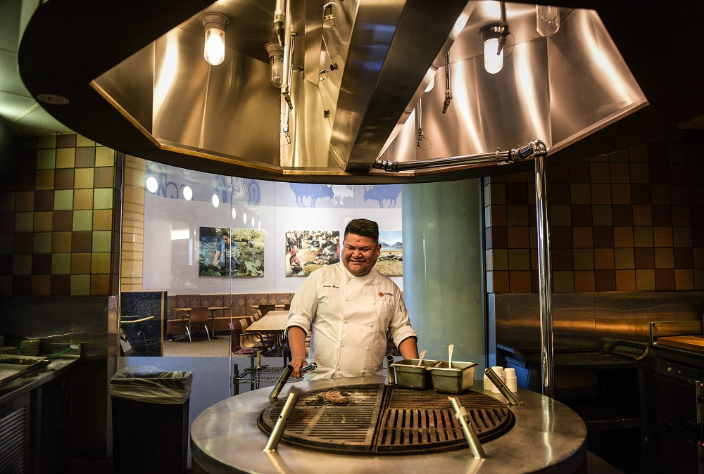 "Bitsoie loves introducing new dishes to his guests. He says being the executive chef of Mitsitam Native Foods Café is his ""dream job."" (© Carol Guzy)"