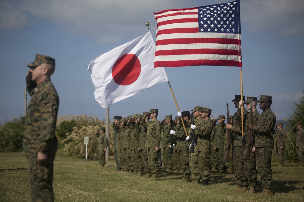 U.S. Marines with 3D Marine Expeditionary Brigade and members of the Japan Ground Self-Defense Force Amphibious Rapid Deployment Brigade salute during the closing ceremony for Exercise Yama Sakura 77 on Camp Courtney, Okinawa, Japan, Dec. 15, 2019