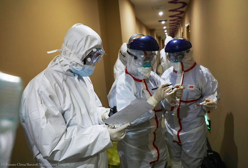 CDC workers in Wuhan, China, examine information collected from patients who may have the 2019 novel coronavirus on February 4. (© Feature China/Barcroft Media/ Getty Images)