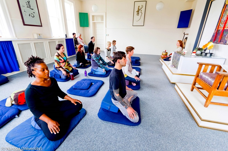 Naropa University in Colorado, the first accredited U.S. Buddhist college, is noted for emphasis on Eastern religions and the arts. Here a meditation class is in session. (© Naropa University)