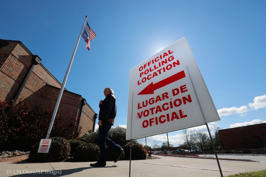 A sign in English and Spanish directs early voters to a polling location in Texas, one of the Super Tuesday states. (© LM Otero/AP Images)