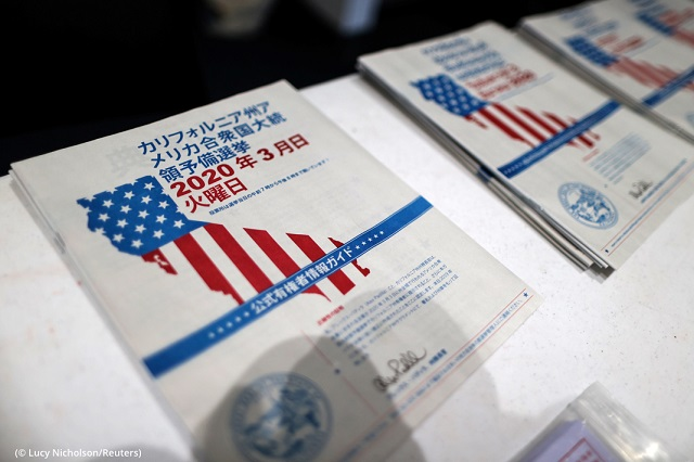 Voter guides are available in multiple languages at a Santa Monica, California, polling station. (© Lucy Nicholson/Reuters)