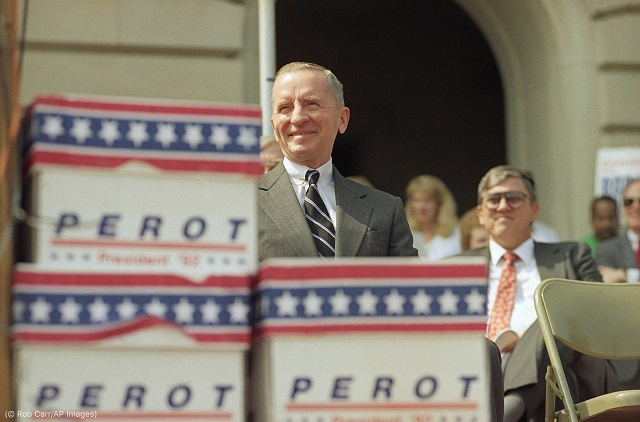 Ross Perot shows off his campaign's hard work: boxes of some 40,000 signatures to put him on the Kentucky primary ballot in 1992. (© Rob Carr/AP Images)