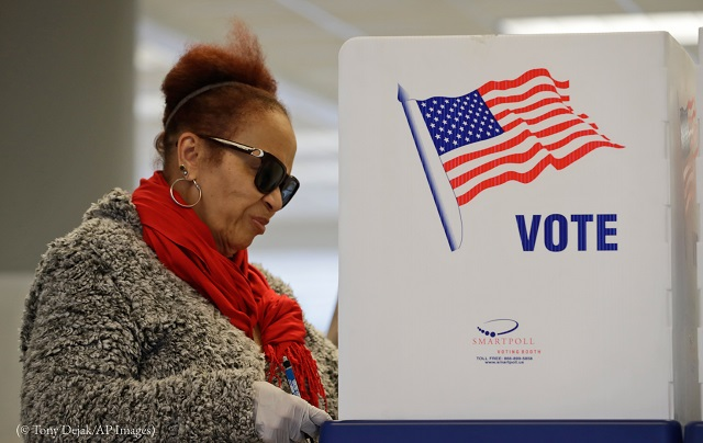 Andrea Anthory takes advantage of early voting March 13 in Cleveland. (© Tony Dejak/AP Images)
