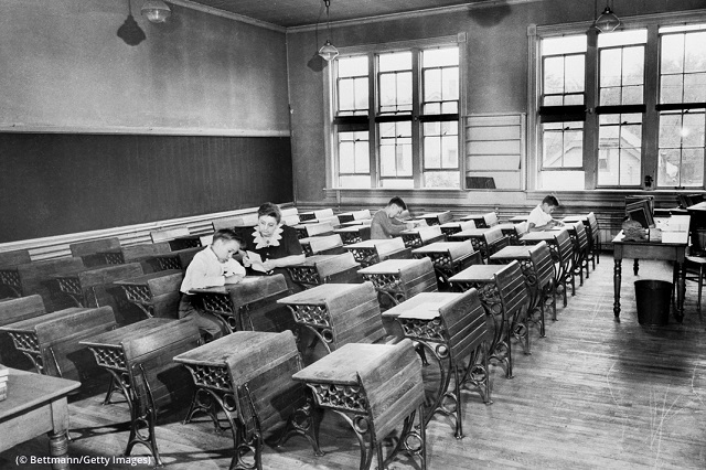 A sixth-grade classroom in Milwaukee on the first day of school in 1944 is barely occupied because of a polio quarantine. (© Bettmann/Getty Images)