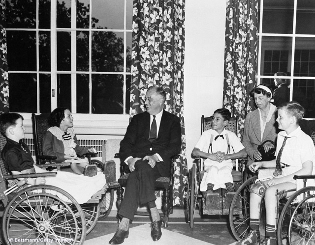 President and Mrs. Franklin Roosevelt enjoy conversation with young polio patients from the Warm Springs Foundation. (© Bettmann/Getty Images)