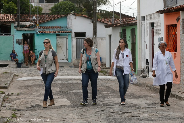Brazilian and U.S. health workers in Joao Pessoa, the capital of Paraíba state in Brazil, search for mothers and their infants to include in a Zika study. (© Andre Penner/AP Images)