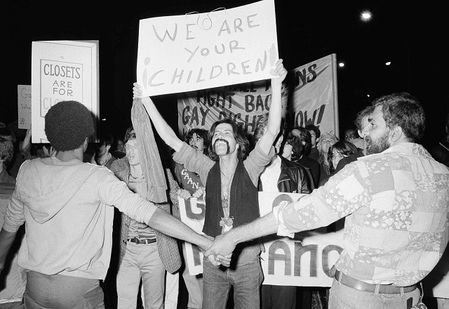 LGBTI rights activists demonstrate in New York's Sheridan Square before beginning a protest march through Manhattan on June 8, 1977. (© AP Images)