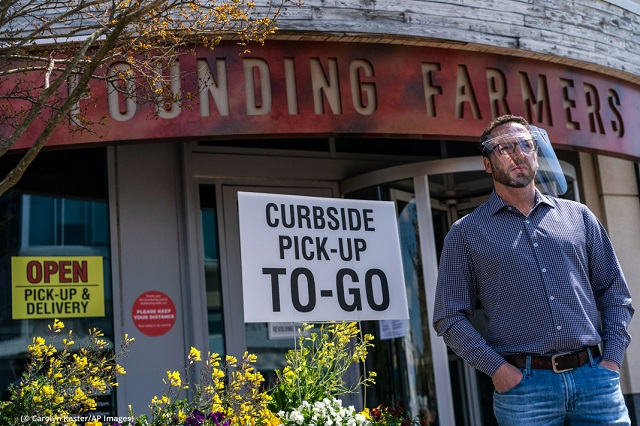 Because COVID-19 has closed many restaurants to on-premises dining, some, like Dan Simons' Founding Farmers in Maryland, are offering delivery and curbside pickup of meals and groceries. (© Carolyn Kaster/AP Images)