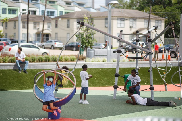 Children play in Houston's Emancipation Park following the park's $34 million renovation in 2017. (© Michael Stravato/The New York Times)