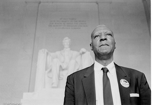 Labor leader A. Philip Randolph in front of the statue of Abraham Lincoln at the Lincoln Memorial in Washington in 1963. (© AP Images)