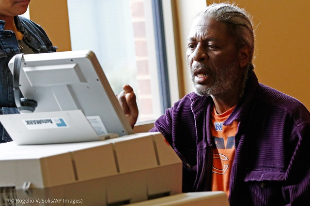 Bernell Jeuitt uses a special machine for voters with visual or hearing impairments in Jackson, Mississippi. (© Rogelio V. Solis/AP Images)