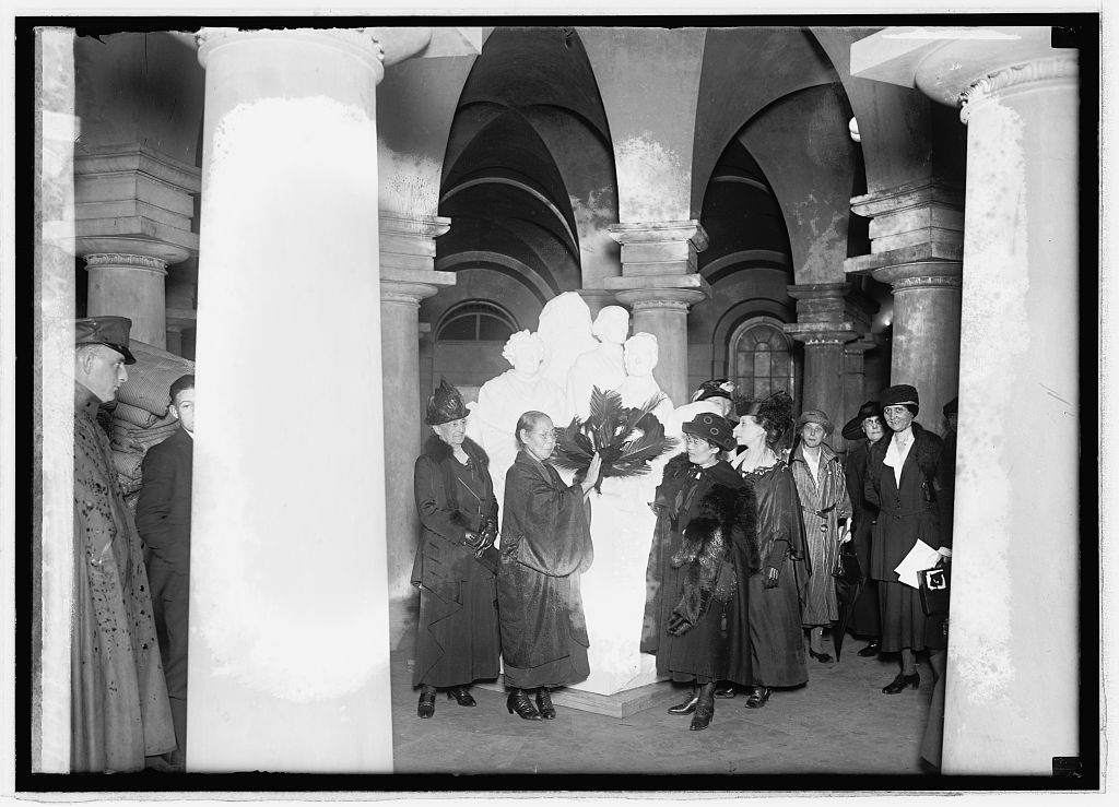 Kajiko Yajima in front of the monument of the three American suffragists during her visit to the United States. November 9, 1921. (Library of Congress)