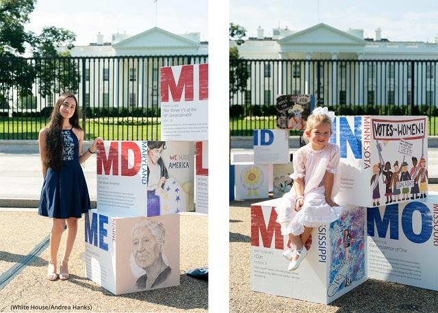 """(Left) Vainavi, a 17-year-old student from Bethesda, Maryland, poses for a photo by her artwork during the opening of """"Building the Movement: America's Youth Celebrate 100 Years of Women's Suffrage"""" August 24. (Right) Vivian, a 5-year-old student from Hattiesburg, Mississippi. (White House/Andrea Hanks)"""