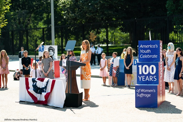"""First lady Melania Trump delivers remarks during the opening of the """"Building the Movement: America's Youth Celebrate 100 Years of Women's Suffrage"""" exhibition August 24 in front of the White House. (White House/Andrea Hanks)"""