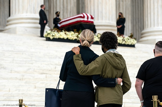 A couple pays their respects as Justice Ruth Bader Ginsburg lies in repose at the U.S. Supreme Court building on September 24. Ginsburg, 87, died of cancer September 18. (© Jose Luis Magana/AP Images)